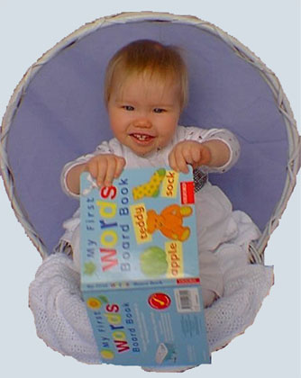 Baby with book in a basket